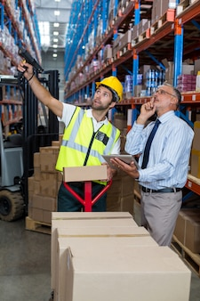 Warehouse manager interacting with male worker