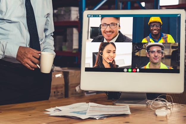 Warehouse staff talking on a video call at work