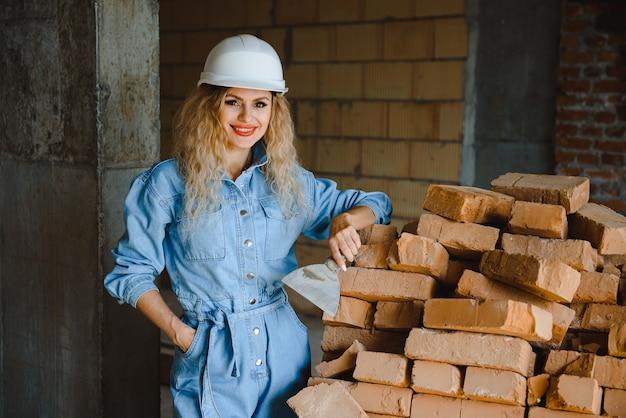 Warehouse woman worker. woman builder in hardhat