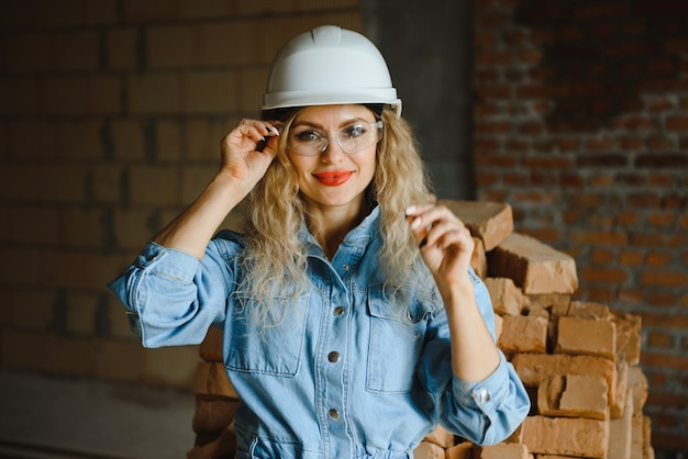 Warehouse woman worker. woman builder in hardhat.