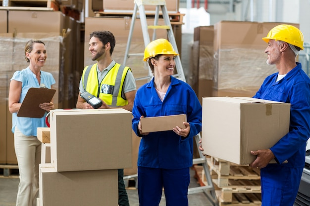 Warehouse worker interacting with each other