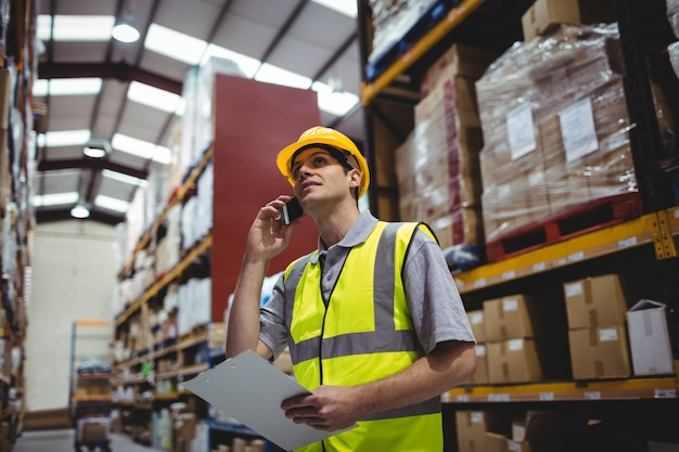 Warehouse worker on a phone call in the warehouse