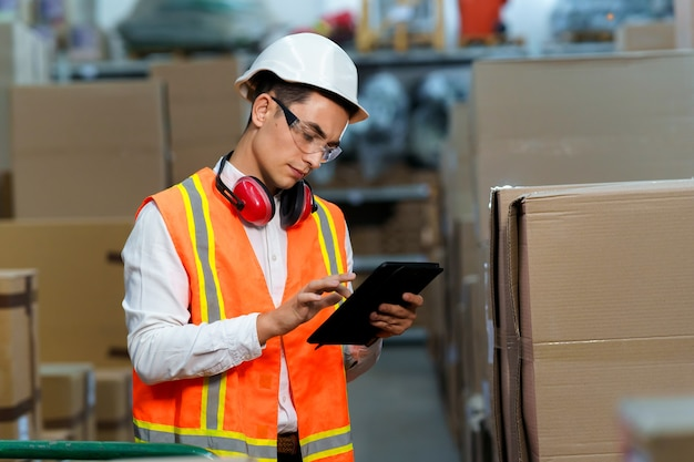 Warehouse worker uses tablet