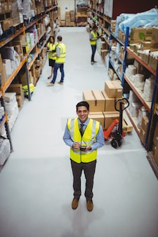Warehouse worker using hand scanner in warehouse