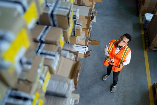 Warehouse worker with touchpad