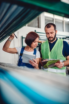 Warehouse workers checking order list