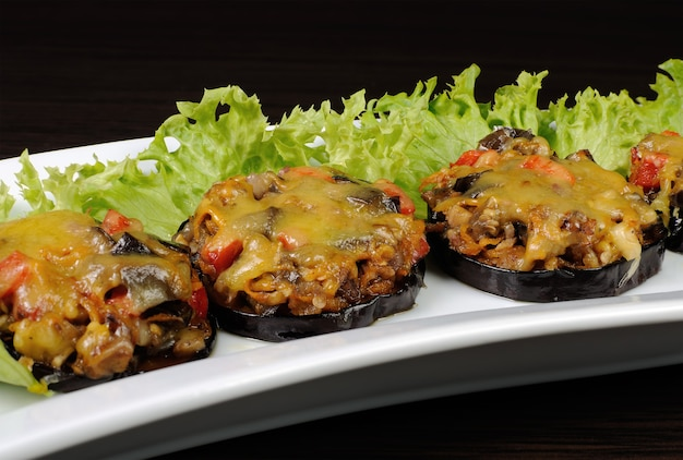 Warm appetizer of eggplant stuffed with vegetables and cheese