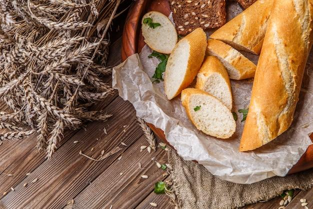 Warm bread in wooden plate