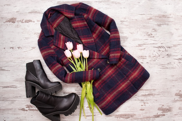 Warm checkered coats, black shoes, tulips.