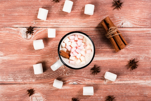 Warm cinnamon and marshmallows drink