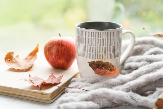Warm composition with hot drink on table