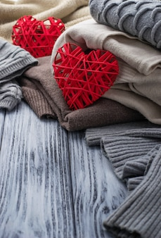 Warm knitted pastel clothes and hearts