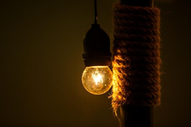 Warm light bulb on dark background