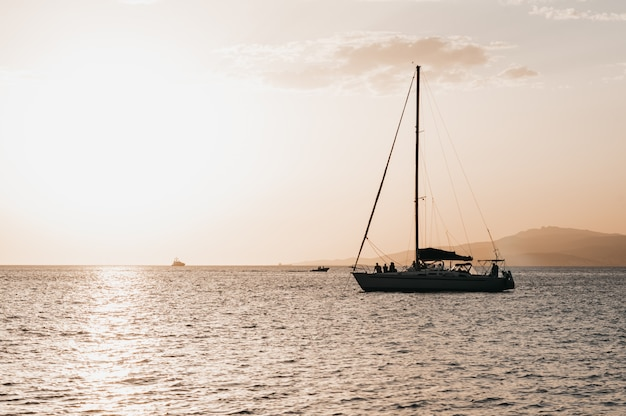 Warm light reddish and orange colors sunset near the sea by boat