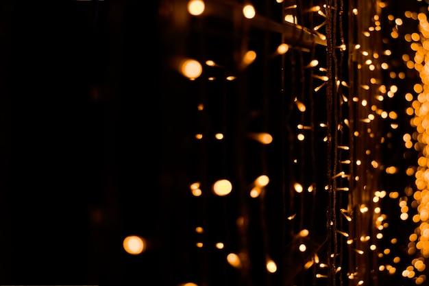 Warm lights of yellow garlands on black