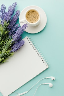 Warm morning coffee with lavender flowers flat lay