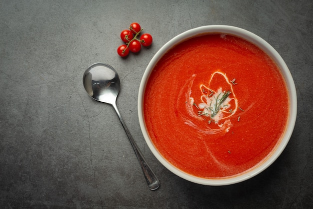 Warm tomato soup serve in bowl