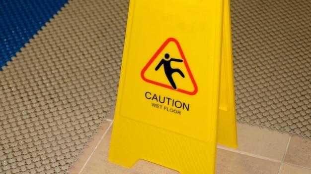 Warning sign caution slippery pool floor