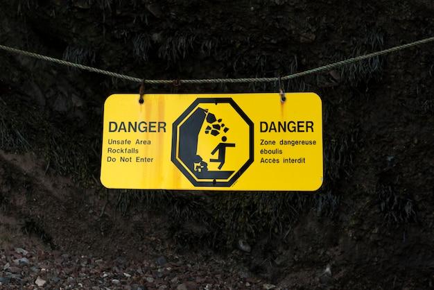 Warning sign at hopewell rocks, bay of fundy, new brunswick, canada