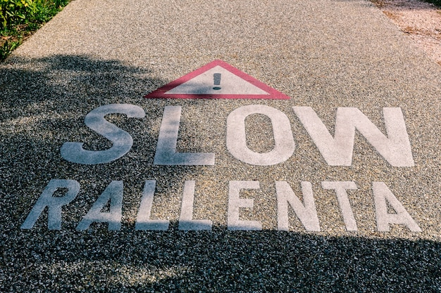 Warning to slow down on the cycle path between garda and bardolino in the province of verona.