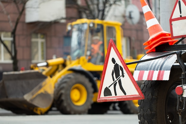 Warning street sign on road work site.
