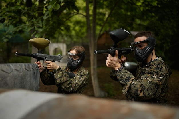 Warriors aimimg with paintball guns, team game