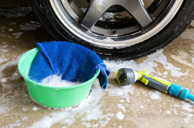 Wash a car fabric and bubbles to clean the car
