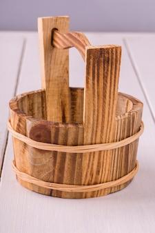Wash hands brown wooden basin on white wooden background