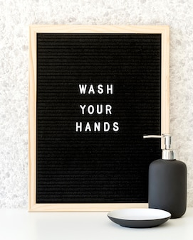 Wash your hands frame with soap dispenser