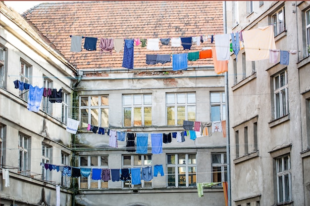 Washed clothes drying outside of an old house. washed clothes drying