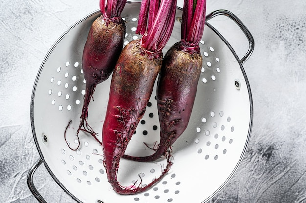 Washed organic purple beetroot in a colander