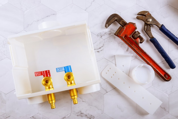 Washer dual drain outlet box and adjustable monkey wrench