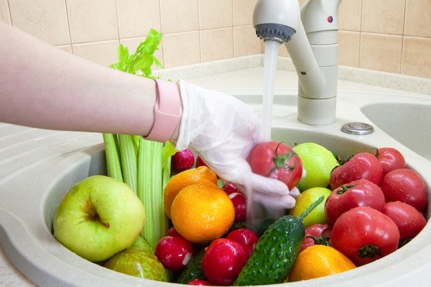 Washing fruits and vegetables after shopping from grocery store