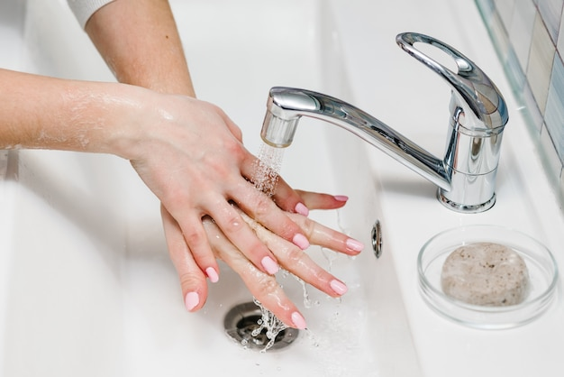 Washing hands. coronavirus prevention. wash hands with antibacterial soap and warm running water rubbing nails and fingers in sink. epidemic covid-19. prevention of flu disease.