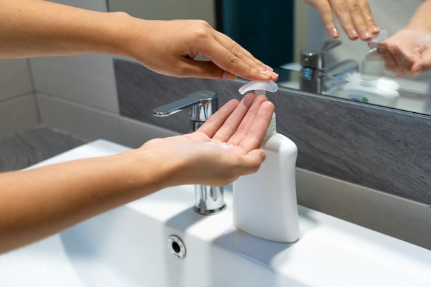 Washing hands rubbing with soap woman