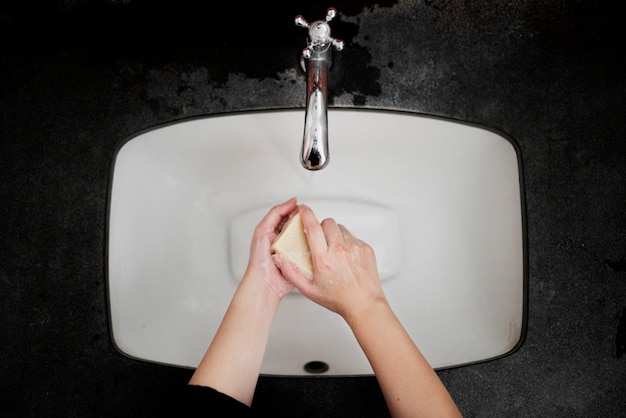 Washing hands with a bar soap