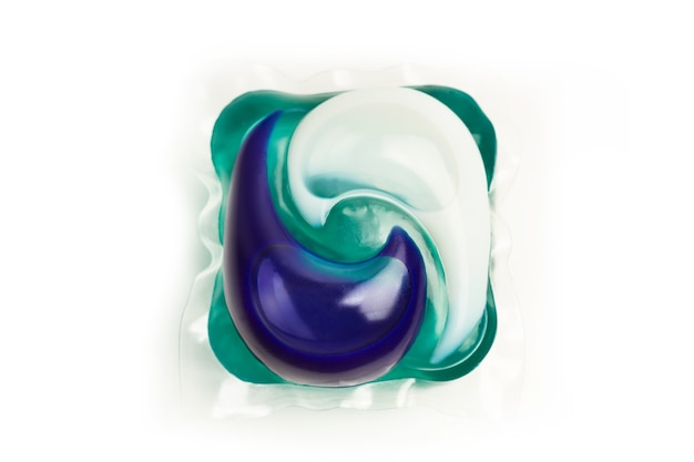 Washing machine detergent pod on a white background in a close up view