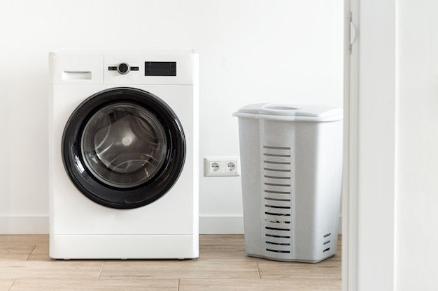 Washing machine with laundry basket in the home laundry room