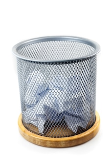 Waste papers and basket on a white background.