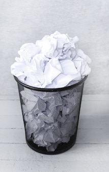 Wasted papers in the garbage bin
