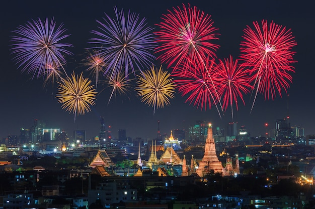 Wat arun and bangkok city with colorful fireworks, thailand