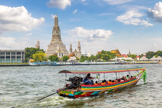 Wat arun temple in bangkok in thailand in a summer day