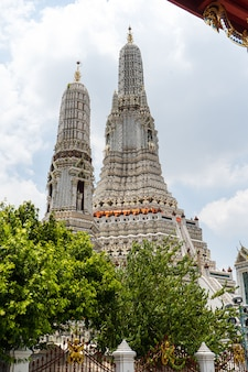Wat arun temple in bangkok thailand. wat arun-buddhist temple in bangkok's yai district of bangkok, thailand, wat arun mosaic close-up