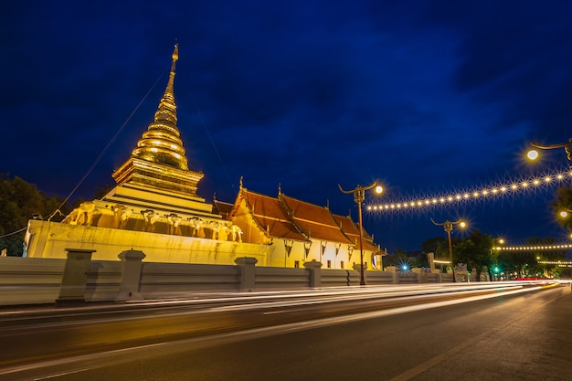 Wat phra that chang kham, buddhist temple with blue twilight night sky, in nan province, north of thailand.