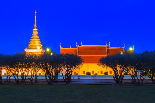 Wat phra that chang kham in twilight time, nan province, thailand