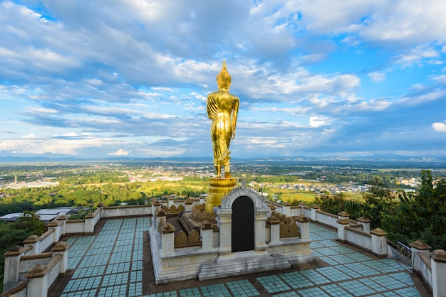 Wat phra that khao noi, nan province, thailand, golden buddha statue standing on a mountain