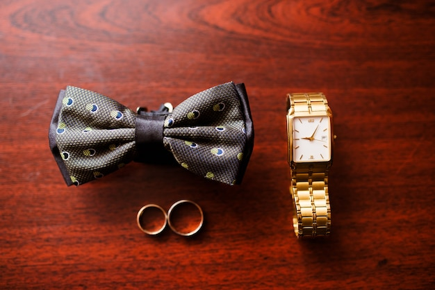 Watch, butterfly and wedding ring.