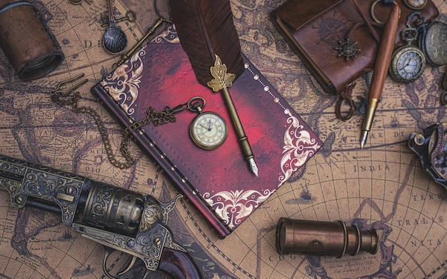 Watch necklace and pen quill on diary book