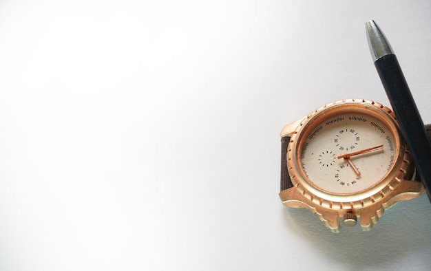 Watch and pen image on white background
