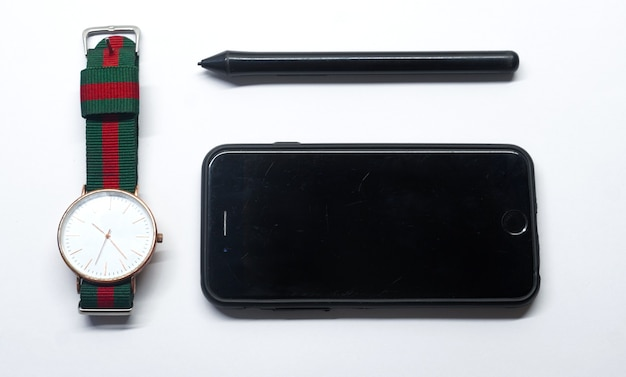 Watch pen and mobile in white background